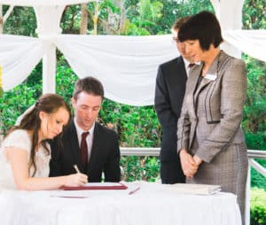 Liz and David sign their Marriage Certificates. Photo by Lionheart Photography